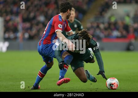London, UK. 22nd Feb, 2020. Joel Ward of Crystal Palace tackling Allan Saint-Maximin of Newcastle United during the Premier League match between Crystal Palace and Newcastle United at Selhurst Park, London on Saturday 22nd February 2020. (Credit: Jacques Feeney | MI News) Photograph may only be used for newspaper and/or magazine editorial purposes, license required for commercial use Credit: MI News & Sport /Alamy Live News - Stock Photo