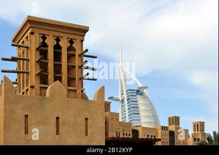Top of the BURJ AL ARAB,7-star hotel,Behind wind towers of the Souk Madinat,Jumeirah,Dubai,United Arab Emirates,Middle East - Stock Photo