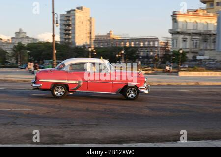 Red Vintage Car at the Malecon,Havana,Cuba,Caribbean - Stock Photo