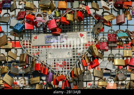 Love locks on Hohenzollern Bridge,Old Town,Cologne,North Rhine Westphalia,Germany - Stock Photo