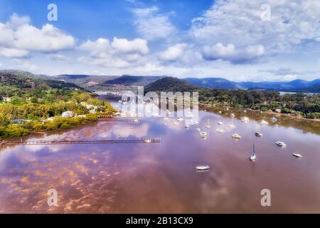 Small aquaculture fishing village on Hawkesbury river in Australia near Sydney - still waters with marina and oyster farms. - Stock Photo