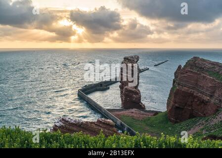 Rock formation 'Lange Anna' at sunset,Helgoland,Schleswig-Holstein,Germany - Stock Photo