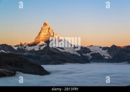 Matterhorn with clouds at sunrise,Switzerland - Stock Photo