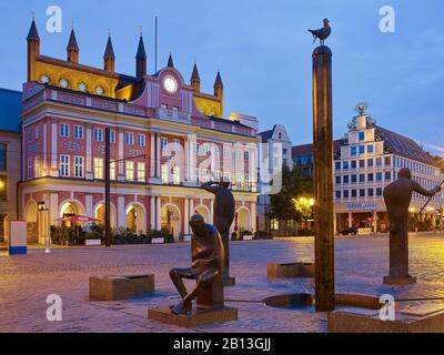 City Hall on New Market Square with Neptune Fountain in Rostock,Mecklenburg-Vorpommern,Germany - Stock Photo