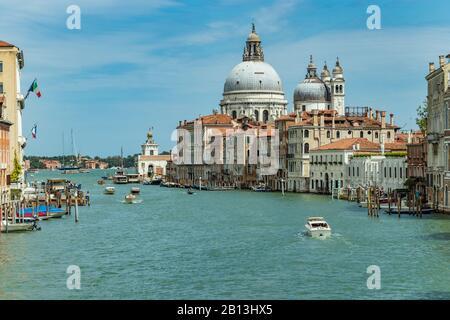 VENICE, ITALY - August 02, 2019: Grand Canal with Basilica di Santa Maria della Salute in Venice, Italy. View of Venice Grand Canal in sunny day. Arch