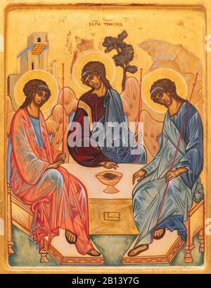 RAVENNA, ITALY - JANUARY 28, 2020: The icon of Holy Trinity (Abraham Hosts the Tree Angels) from the chruch Chiesa di Santa Maria Maddalena. - Stock Photo