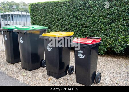 Australian household bin collection, green vegetation, red general waste, , yellow for plastics and glass, Sydney,Australia - Stock Photo