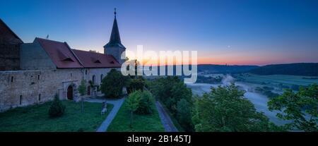 Monastery church Zscheiplitz at sunrise, morning fog in the Unstrut valley, Freyburg, Saxony-Anhalt, Germany