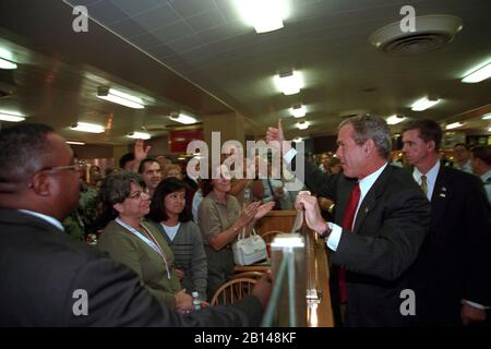 President George W. Bush gives a 'thumbs up' Monday, Sept. 17, 2001, to employees gathered in the cafeteria of the Pentagon in Arlington, Va.  Photo by Eric Draper, Courtesy of the George W. Bush Presidential Library - Stock Photo