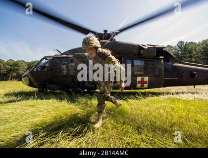 A U.S. Army UH-60 Black Hawk helicopter crew assigned to the South Carolina Army National Guard, Charlie Co., 2-238 Aviation Battalion provides medevac support during Exercise STEPPE EAGLE 18 at McCrady Training Center, Eastover, South Carolina, Aug. 17, 2018.Exercise STEPPE EAGLE is an annual multi-national exercise that is conducted by the U.S. Army, Armed Forces of the Republic of Kazakhstan, Armed Forces of the Republic of Tajikistan and the United Kingdom Armed Forces. U.S. Army Central executed the exercise with support from the Arizona and South Carolina Army National Guard.(U.S. Arm - Stock Photo