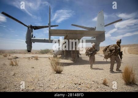 U.S. Marines assigned to 2nd Battalion, 7th Marine Regiment dismount an MV-22B Osprey assigned to Marine Medium Tiltrotor Squadron 263 while conducting a tactical insert during Integrated Training Exercise (ITX) 5-19 at Marine Corps Air Ground Combat Center, Twenty-nine Palms, California, Aug. 3, 2019. ITX 5-19 is a large scale, combined-arms training exercise that produces combat-ready forces capable of operating as an integrated Marine Air-Ground Task Force. (U.S. Marine Corps photo by Cpl. Cody Rowe) Stock Photo