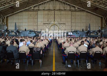 An audience waits for the invocation of a memorial ceremony to honor nine U.S. Marines assigned to Marine Aerial Refueler Transport Squadron 452, Marine Aircraft Group 49, 4th Marine Aircraft Wing, Marine Forces Reserve, at Stewart Air National Guard Base in Newburgh, New York, Aug. 27, 2017. The memorial was held to honor the lives of nine VMGR-452 Marines who perished in a KC-130T accident that killed 15 Marines and one Sailor, July 10, 2017. (U.S. Marine Corps photo by Cpl. Dallas Johnson) - Stock Photo
