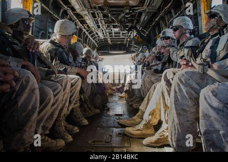 U.S. Marines with the 2nd Battalion, 6th Marine Regiment are transported by a CH-53E Super Stallion helicopter assigned to Marine Heavy Helicopter Squadron (HMH) 466 during an exercise as part of Weapons and Tactics Instructors course (WTI) 2-17 near Yuma, Ariz., April 20, 2017. WTI is held biannually at Marine Corps Air Station (MCAS) Yuma, Ariz., to provide students with detailed training on the various ranges in Arizona and California. (U.S. Marine Corps photo by Cpl. Trever A. Statz) Stock Photo