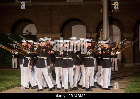 The U.S. Marine Corps Silent Drill Platoon executes the 'bursting bomb' during a Friday Evening Parade at Marine Barracks Washington D.C., May 5, 2017. The guests of honor for the parade were Rep. Paul Cook of California's 8th Congressional District, Rep. Jack Bergman of Michigan's 1st Congressional District, and Rep. Salud Carbajal of California's 24th Congressional District. The hosting official was Gen. Glenn Walters, the assistant commandant of the Marine Corps. (U.S. Marine Corps photo by Cpl. Robert Knapp) - Stock Photo