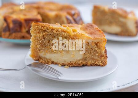 home made carrot cake cheesecake on a table - Stock Photo