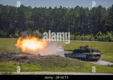 U.S. Marines fire an M1A1 Abrams tank at moving targets down range at Camp Lejeune, N.C., June 9, 2017. The Marines participated in the 14th annual Tiger Competition, a rivalry between tank crews from 1st, 2nd, and 4th Tank Battalion, to determine the top performing tank crew in the Marine Corps. The Marines are with 2nd Tank Battalion. (U.S. Marine Corps photo by Lance Cpl. Taylor W. Cooper) - Stock Photo
