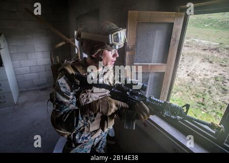U.S. Marine Corps Lance Cpl. Patrick Giblin, an infantryman with the 3rd Battalion, 4th Marine Regiment, 1st Marine Division, wears a concept communication system during Urban Advanced Naval Technology Exercise 2018 (ANTX18) at Marine Corps Base Camp Pendleton, California, March 21, 2018. The Marines are testing next generation technologies to provide the opportunity to assess the operational utility of emerging technologies and engineering innovations that improve the Marine's survivability, lethality and connectivity in complex urban environments. (U.S. Marine Corps photo by Lance Cpl. Rhita