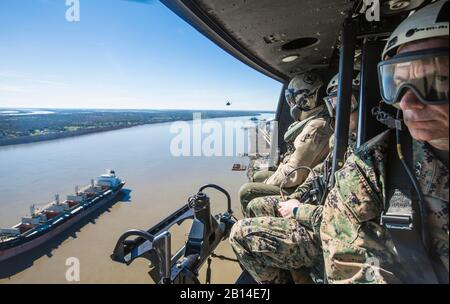 U.S. Marines ride in a UH-1Y Venom over New Orleans, La., Feb. 16, 2017. Commandant of the Marine Corps Gen. Robert B. Neller visited Marine Forces Reserve to talk with Marines about his recent message to the force 'Seize the Initiative.' (U.S. Marine Corps photo by Cpl. Samantha K. Braun) - Stock Photo