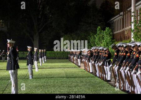 """Marines with Alpha and Bravo marching companies, Marine Barracks Washington D.C., perform """"fix bayonets"""" during a Friday Evening Parade at the Barracks, May 10, 2019.The guest of honor for the evening was the Honorable, David L. Norquist, Under Secretary of Defense (Comptroller)/Chief Financial Officer and performing the duties of the Deputy Secretary of Defense and the hosting official was the Assistant Commandant of the Marine Corps, Gen. Gary L. Thomas. (U.S. Marine Corps photo by Pfc. Allen Sanders) - Stock Photo"""