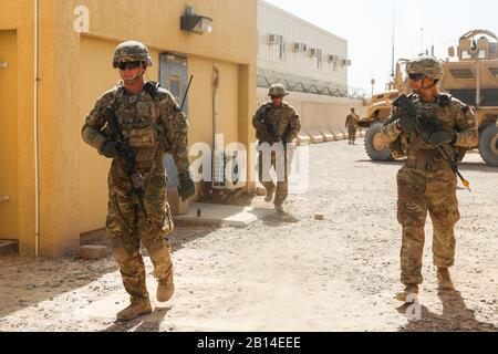 KANDAHAR AIRFIELD, Afghanistan (Aug. 16, 2018) -- U.S. Army Soldiers from 1st Battalion, 12th Infantry Regiment, 2nd Infantry Brigade Combat Team, 4th Infantry Division, walk into a simulated village,Aug. 16, 2018,  during a Guardian Angel situational training exercise in Kandahar Airfield, Afghanistan. Soldiers from Alpha Company, 1st Bn., 12th Inf. Reg. are responsible for providing Guardian Angel Soldiers for missions where advisors from Train Advice and Assist Command-South conduct with their Afghan National Army and Afghan National Police counterparts through the Kandahar province. (U.S. - Stock Photo
