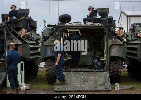 U.S. Marines with Headquarters and Service Company, 2nd Assault Amphibian Battalion, 2nd Marine Division, inspect AAV-P7/A1 assault amphibious vehicles during a deployment for training (DFT) exercise at Fort Stewart, Georgia, May 17, 2018. Marines performed pre-operations checks to ensure all equipment, machinery and vehicles run smoothly. The DFT helped maintain proficiency in landing the surface assault element during amphibious operations to inland objectives with conduction mechanized operations and related combat support in operations ashore. (U.S. Marine Corps photo by Lance Cpl. Christi - Stock Photo