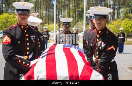 U.S. Marines with Marine Forces Reserve conduct military funeral honors for retired Lt. Col. Dennis Stegall at Southeast Louisiana Veterans Cemetery in Slidell, La., April 1, 2019. Stegall retired from the Marine Corps after 23 years of service in 2006 and continued to serve as the Marine Corps deputy comptroller for MARFORRES. (U.S. Marine Corps photo by Sgt. Dante J. Fries) - Stock Photo