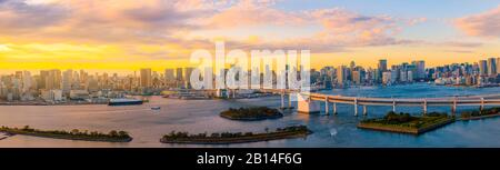 Panoramic Aerial view of Tokyo skylines with Rainbow bridge and tokyo tower over Tokyo bay in daytime from Odaiba in Tokyo city Kanto Japan. panorama Stock Photo