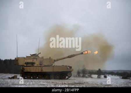 A U.S. Army M109A6 Paladin howitzer, assigned to Bravo Battery, 1st Battalion, 82nd Field Artillery Regiment, 1st Armored Brigade Combat Team, 1st Cavalry Division, fires its main gun at a range during Table Six qualifications at U.S. Army Garrison Bavaria in Grafenwoehr, Germany, Jan. 9, 2019. Ironhorse Soldiers are training in Germany as they close out their rotation across Europe in support of Atlantic Resolve. (U.S. Army National Guard photo by Sgt. Lisa Vines)