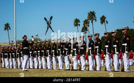 The U.S. Marine Corps Silent Drill Platoon, Marine Barracks Washington, D.C., perform during the Battle Color Ceremony at Marine Corps Air Station Yuma, Ariz., March 2, 2017. The ceremony was held to celebrate Marine Corps history using music, marching and precision drill. (U.S. Marine Corps photo by Lance Cpl. Christian Cachola/Released) - Stock Photo