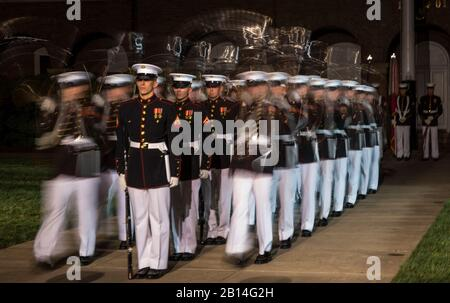 "The U.S. Marine Corps Silent Drill Platoon executes ""Meat Grinders"" during the Friends and Family Evening Parade at the Barracks, Apr. 28, 2017. The guest of honor for the parade was the Commandant of the Marine Corps Gen. Robert B. Neller and the hosting official was the Barracks' commanding officer, Col. Tyler J. Zagurski. - Stock Photo"