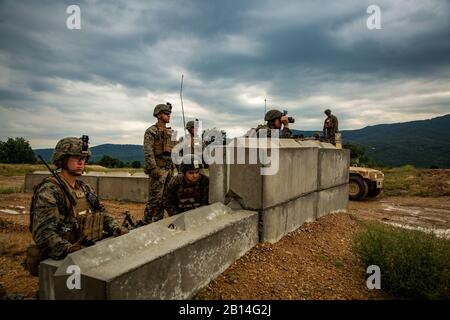 U.S. Marines with Black Sea Rotational Force 18.1 observe a target to be engaged with an FGM-148 Javelin anti-tank missile launcher during a deployment for training exercise at Novo Selo Training Area, Bulgaria, July 5, 2018. Marines with Weapons Company, 1st Battalion, 6th Marine Regiment conducted five days of live-fire ranges, enhancing their operational capabilities. (U.S. Marine Corps photo by Cpl. Alexander Sturdivant) - Stock Photo