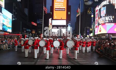 U.S. Marines with the 'The Commandant's Own,' United States Marine Drum & Bugle Corps, Marine Barracks Washington, D.C., perform for the crowds during a USMC Battle Colors Detachment Performance during Fleet Week New York in Times Square, New York, May 26, 2018. Now in its 30th year, Fleet Week  is the city's time-honored celebration of the sea services. It is an unparalleled opportunity for the citizens of New York and the surrounding tri-state area to meet Marines, Sailors, and Coast Guardsmen, as well as witness firsthand the latest capabilities of today's maritime services. (U.S. Marine Co - Stock Photo