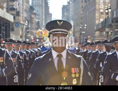 U.S. Air Force Senior Airman Jamar Jackson, a United States Air Force Honor Guard ceremonial guardsman, marches in the Veterans Day Parade in New York, Nov. 11, 2018. The Honor Guard performed in the parade to honor veterans and to inspire, recruit and retain future Airmen. (U.S. Air Force photo by Airman 1st Class Michael S. Murphy) - Stock Photo
