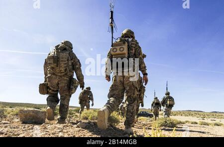 U.S. Air Force explosive ordnance disposal (EOD) technicians assigned to the 99th Civil Engineer Squadron walk onto a range for training at Nellis Air Force Base, Nev., May 3, 2017. EOD technicians are trained to detect, disarm, detonate and dispose of explosive threats all over the world. (U.S. Air Force photo by Senior Airman Kevin Tanenbaum) - Stock Photo