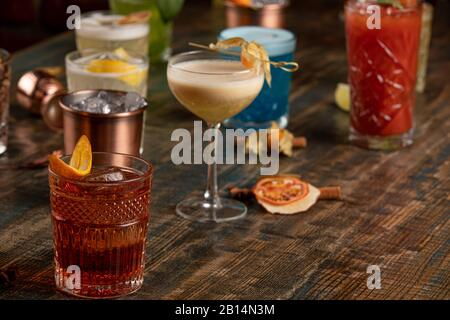 Many different multi-colored cocktails with different colors - Stock Photo