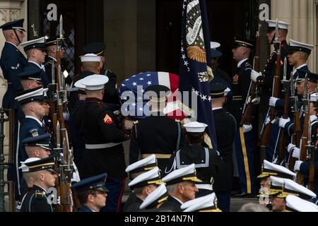 U.S. service members with the Ceremonial Honor Guard carry the casket of George H.W. Bush, the 41st President of the United States, into the National Cathedral in Washington, D.C., Dec. 5, 2018. Bush's funeral took place inside the cathedral where thousands gathered pay their respects. (DoD photo by U.S. Army Spc. Lane Hiser)
