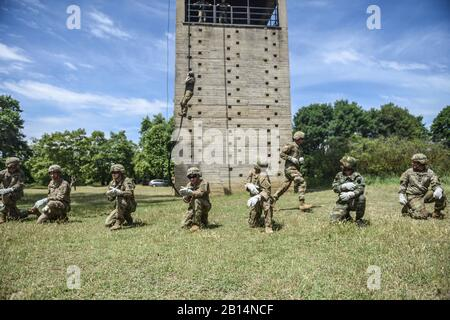 Greek paratroopers with the 1st Paratrooper Commando Brigade, Greek Army conduct rappelling and fast rope training for Sky Soldiers from B Company, 1st Battalion, 503rd Infantry Regiment, 173rd Airborne Brigade, May 19, 2017, at Camp Rentina, Greece, as a part of Exercise Bayonet Minotaur 2017. Bayonet-Minotaur is a bilateral training exercise between U.S. Soldiers assigned to 173rd Airborne Brigade and the Greek Armed Forces, focused on enhancing NATO operational standards and developing individual technical skills. (U.S. Army photo by Staff Sgt. Philip Steiner) - Stock Photo