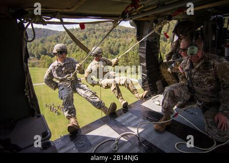 U.S. Soldiers in Air Assault class 307-17 rappel from a UH-60 Black Hawk helicopter to complete Air Assault training in Kingwood, West Virginia. (U.S. Army National Guard photo by Sgt. Mickey Miller) - Stock Photo