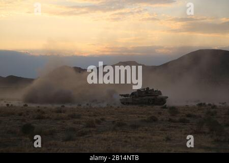 U.S. Soldiers assigned to 1st Battalion, 38th Infantry Regiment, 1st Stryker Brigade Combat Team, 4th Infantry Division, engage a target during live fire exercise to an objective during Decisive Action Rotation 17-07.5 at the National Training Center, Fort Irwin, Calif., July 6,  2017. (U.S. Army photo by Sgt. Ernesto Gonzalez) - Stock Photo