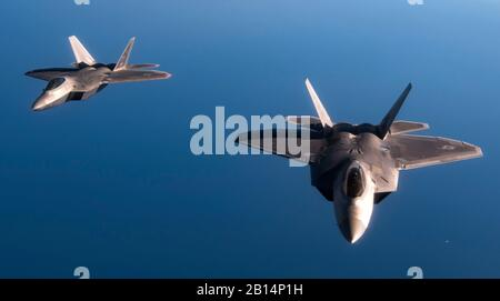 U.S. Air Force F-22 Raptors from the 95th Fighter Squadron, 325th Fighter Wing, Tyndall Air Force Base, Fla., fly in formation after an air refueling over the Mediterranean Sea. After refueling, the F-22s trained with Spanish aircraft and landed at Los Llanos Air Base in Albacete, Spain where a pilot briefed the Raptor's capabilities to military and civilian personnel from NATO allied nations. (U.S. Air Force photo by Senior Airman Preston Cherry) - Stock Photo