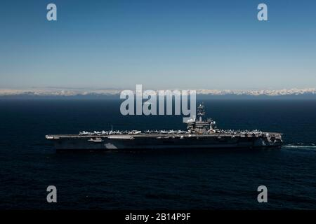 190524-N-XC372-1160 GULF OF ALASKA (May 24, 2019) The aircraft carrier USS Theodore Roosevelt (CVN 71) transits the Gulf of Alaska. Theodore Roosevelt is conducting routine operations in the Eastern Pacific. (U.S. Navy photo by Mass Communication Specialist 2nd Class Anthony J. Rivera/Released) - Stock Photo
