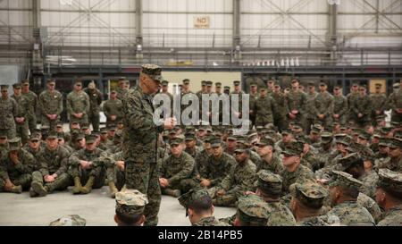 Commandant of the Marine Corps Gen. Robert B. Neller addresses Marines and Sailors assigned to Special Purpose Marine Air-Ground Task Force-Crisis Response-Africa, during a ceremony at Naval Air Station Sigonella, Italy, Dec. 25, 2017. Neller and Sgt. Maj. Ronald L. Green, sergeant major of the Marine Corps stopped by NAS Sigonella to spend time with SPMAGTF-CR-AF service members during the holidays. SPMAGTF-CR-AF is deployed to conduct crisis-response and theater-security operations in Europe and Africa. (U.S. Marine Corps photo by Lance Cpl. Patrick Osino) - Stock Photo