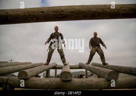 U.S. Marine Corps Capt. Cameron Heard, left, and U.S. Marine Corps Staff Sgt. Michael Birch, right, Challenge Reconnaissance competitors representing U.S. Marine Corps Sgt. W. D. Wilson, walk down logs during the innaugural Challenge Reconnaissance on Camp Pendleton, Calif., April 27, 2017. The event provided an opportunity for Marines of any military occupational specialty to honor fallen recon Marines. The challenge consists of 24 miles of hiking, helocasting, scout swimming, a memory challenge, obstacle course, close quarters tactics, live fire range and 2 pool stations. (U.S. Marine Corps - Stock Photo