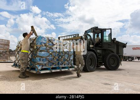 U.S. Airmen with from the 502nd Logistics Readiness Squadron, 74th Aerial Port Squadron, 26th APS and 733rd Training Squadron volunteer to prepare supplies for transport at Joint Base San Antonio-Lackland, Texas, for Hurricane Maria relief efforts Sept. 21, 2017.  Members palletized water and food that Federal Emergency Management Agency donated to aid those in St. Croix, Puerto Rico. (U.S. Air Force photo by Ismael Ortega) - Stock Photo