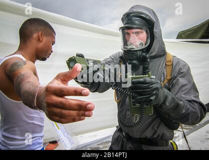 U.S. Army Spc. Nicholas Threatte, a chemical decontamination specialist and native of Darlington, South Carolina, assigned to the Army Reserve 413th Chemical Company, 457th Chemical Battalion, 415th Chemical Brigade, Task Force 76, checks radiation levels on a simulated victim of a chemical attack during a training exercise at Homestead Miami Speedway, Homestead, Florida, Jan. 24, 2019, as part of Operation Homestead 19. Nearly 300 Army Reserve Soldiers assigned to Task Force 76 along with more than 100 personnel from the Miami-Dade Fire Department and several other civilian agencies spent the