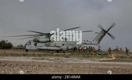 U.S. Marines with Marine Wing Support Squadron (MWSS) 373, Marine Wing Support Group (MWSG) 37, 3rd Marine Aircraft Wing (MAW), unload gear from a CH-53E Super Stallion on the runway at Airport in the Sky on Catalina Island, California, Jan. 9, 2019. The partnership between the Marine Corps and the Catalina Island Conservancy provides a unique opportunity to conduct applicable training while also helping the community. (U.S. Marine Corps photo by Cpl. Samuel Ruiz) - Stock Photo