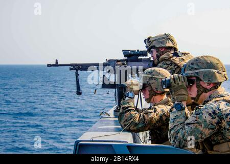 170304-N-JH293-292 EAST CHINA SEA (March 4, 2017) Marines assigned to Battalion Landing Team 2nd Battalion, 5th Marines, participate in a defense of the amphibious task force (DATF) gunnery exercise aboard the amphibious transport dock ship USS Green Bay (LPD 20). During the DATF exercise, Green Bay's small caliber action team (SCAT) worked together with Marines from the 31st Marine Expeditionary Unit (MEU) in order to provide 360-degree coverage of the ship. Green Bay, with embarked 31st MEU, is on a routine patrol, operating in the Indo-Asia-Pacific region to enhance partnerships and be a re - Stock Photo