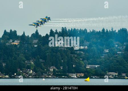 170805-N-SH284-443 SEATTLE (Aug. 5, 2017) The U.S. Navy Flight Demonstration Squadron, the Blue Angels, fly in formation over Lake Washington, during the 68th annual Seafair Fleet Week. Seafair Fleet Week is an annual celebration of the sea services wherein Sailors, Marines and Coast Guard members from visiting U.S. Navy and Coast Guard ships and ships from Canada make the city a port of call. (U.S. Navy photo by Mass Communication Specialist 2nd Class Vaughan Dill/Released) - Stock Photo