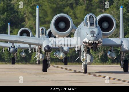U.S. Air Force A-10 Thunderbolt II aircraft assigned to the 74th Fighter Squadron's taxi July 11, 2017, at Moody Air Force Base, Georgia. More than 300 Airmen deployed to Southwest Asia to aid the 74th Fighter Squadron's A-10 mission in support of Operation Inherent Resolve. (U.S. Air Force photo by Senior Airman Greg Nash) - Stock Photo