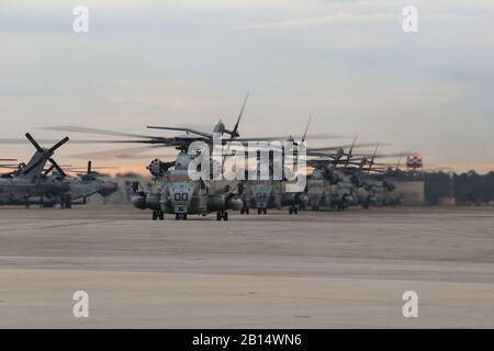 U.S. Marine Corps CH-53 Super Stallion helicopters assigned to Marine Heavy Helicopter Squadron (HMH) 366, 24th Marine Expeditionary Unit, land at Marine Corps Air Station New River, North Carolina, Nov. 30, 2018, after taking part in Exercise Trident Juncture 2018. The squadron participated in the NATO exercise from USS Iwo Jima (LHD7) in Iceland and Norway. The Marines and Sailors were instrumental in providing vertical lift and transport capabilities in an amphibious environment while training in a challenge climate, enabling the MEU to offload combat capabilities and equipment. (U.S. Marin